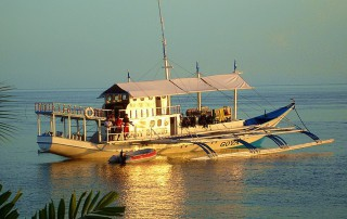 Dive Safari boat in the Philippines: Enjoying the sunset at one of the islands