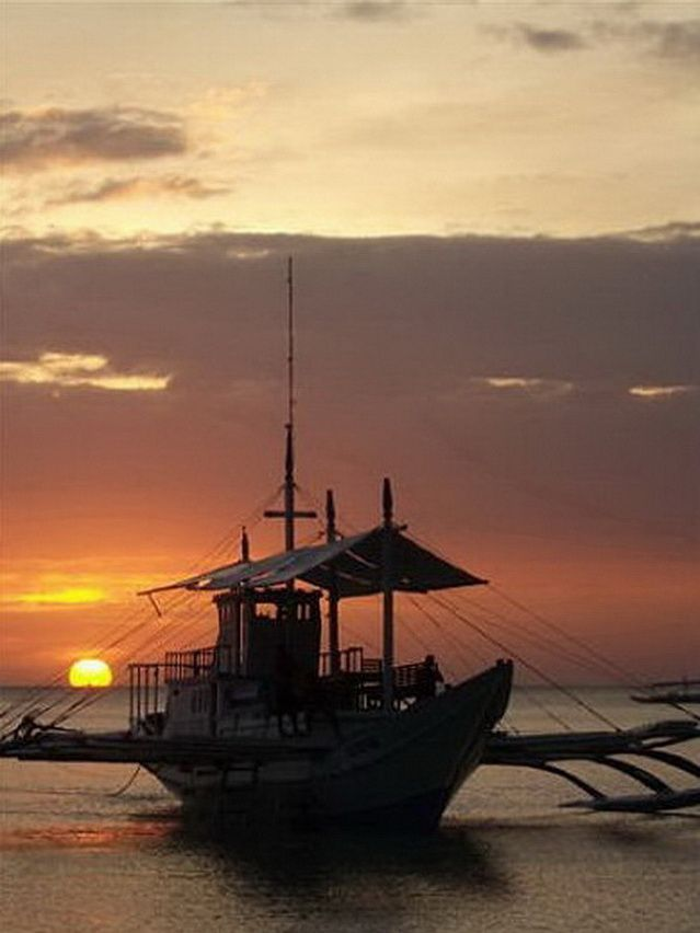 Dive Safari Outrigger Boat and Sunset in the Philippines