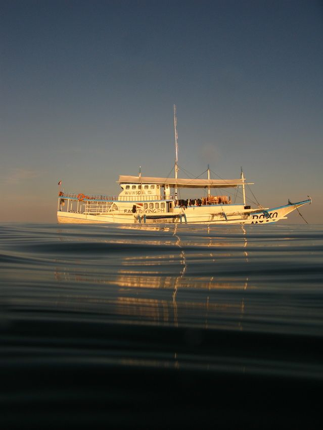 Calm sea and a dive safari boat in the Philippines